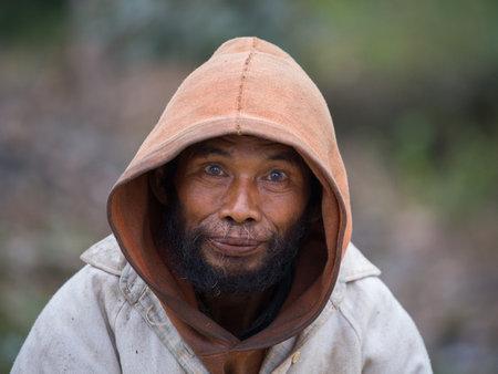 MRAUK-U, MYANMAR - JANUARY 27, 2016: Unknown portrait beggar man, outdoors, Burma Editorial