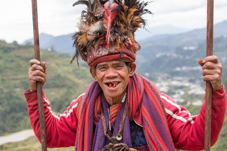 filipino people: BANAUE, PHILIPPINES - JANUARY 24, 2014 : Portrait old Filipino man of Ifugao mountain tribes in national dress next to rice terraces. Ifugao - the  mountain people in the Philippines. Editorial