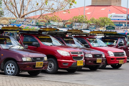 'koh samui': KOH SAMUI, THAILAND - APRIL 18, 2016 : Songthaew pick-up truck at Nathon pier in Koh Samui. Songthaews are used as public share taxis in Thailand with set routes. Editorial