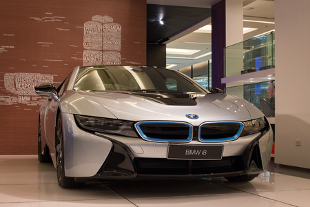 paragon: BANGKOK, THAILAND - JANUARY 07, 2016 : BMW i8 car on display at the Siam Paragon Mall in Bangkok. With 300,000 sqm of retail space Siam Paragon is one of the worlds largest malls. Editorial