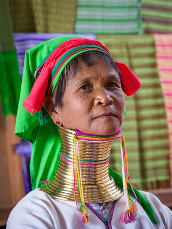 necked woman: INLE LAKE, MYANMAR - JANUARY 14 2016: Padaung Tribal woman poses for a photo in Inle lake, Myanmar, Burma The Padaung-Karen long-necked tribe women are minority of Myanmar.