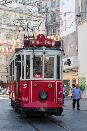 tunel: ISTANBUL, TURKEY - JULY 31, 2015 : The Taksim Tunel Nostalgia Tram trundles along the istiklal street and people at istiklal avenue