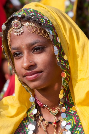 ethnic attire: PUSHKAR, INDIA - NOVEMBER 21, 2012 : Portrait of Indian girl in colorful ethnic attire at Pushkar Camel Mela in Rajasthan, India. Pilgrims and camel traders flock to the holy town for the annual fair. Editorial