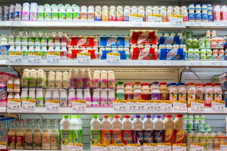grocers: BANGKOK, THAILAND - NOVEMBER 18, 2013 : Selection of yogurts, soy milk and milk on the shelves in a supermarket Siam Paragon in Bangkok, Thailand. Editorial