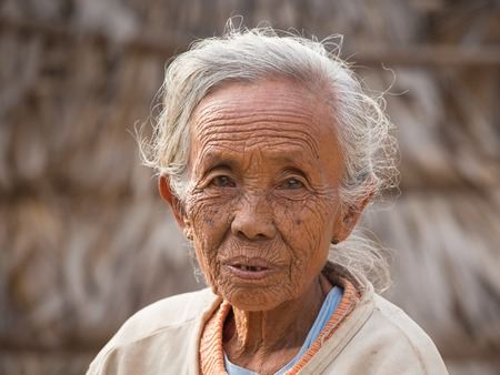 channeled: BAGAN, MYANMAR - JANUARY 21, 2016: Unidentified old woman who participated in the donation channeled ceremony Shinbyu, marking the samanera ordination of a boy under the age of 20