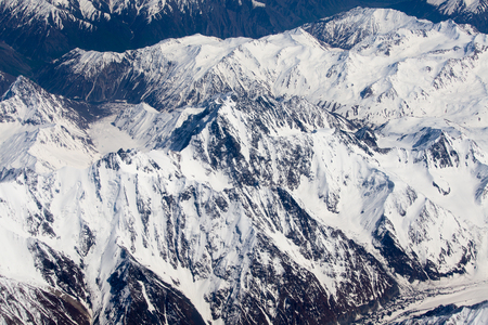 Aerial views in Tibet fly over to mountain Himalaya . View from the plane window Stock Photo