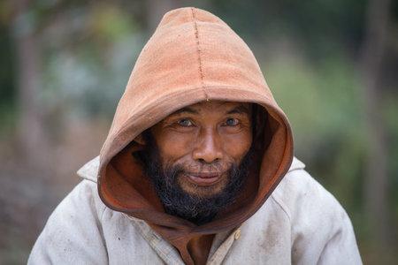 underprivileged: MRAUK-U, MYANMAR - JANUARY 27, 2016: Unknown portrait beggar man,, Burma