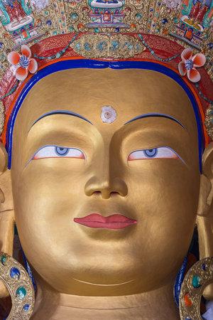 monastic: Close up colorful sculpture of Maitreya buddha at Thiksey Monastery, Tibetan Buddhist monastery in Ladakh, India