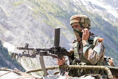 frontier: JAMMU AND KASHMIR, INDIA - JUNE 12, 2015 : Unknown Indian frontier guard. Indian Army checkpoint in Kashmir Himalayas. Kashmir became dangerous again Editorial