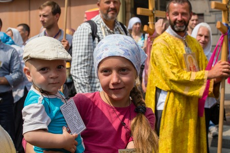 procession: KIEV, UKRAINE - JULY 27, 2016 : Children and parishioners Ukrainian Orthodox Church Moscow Patriarchate in religious procession. At present there is war of Kiev Patriarchate and Moscow Patriarchate