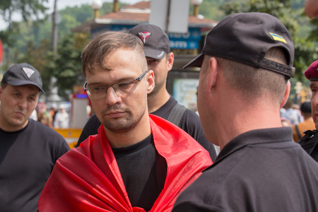 detention: KIEV, UKRAINE - JULY 27, 2016 : Detention of a member of the volunteer battalion Sich national police during religious procession parishioners Ukrainian Orthodox Church Moscow Patriarchate Editorial