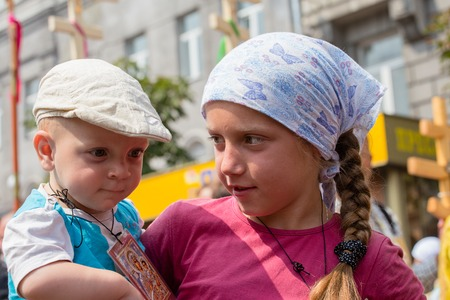 KIEV, UKRAINE - JULY 27, 2016 : Children and parishioners Ukrainian Orthodox Church Moscow Patriarchate in religious procession. At present there is war of Kiev Patriarchate and Moscow Patriarchate