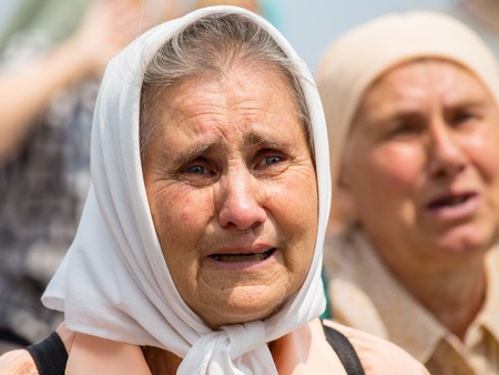 believers: KIEV, UKRAINE - JULY 27, 2016 : Parishioners Ukrainian Orthodox Church Moscow Patriarchate during religious procession. At present there is undeclared war of Kiev Patriarchate and Moscow Patriarchate Editorial