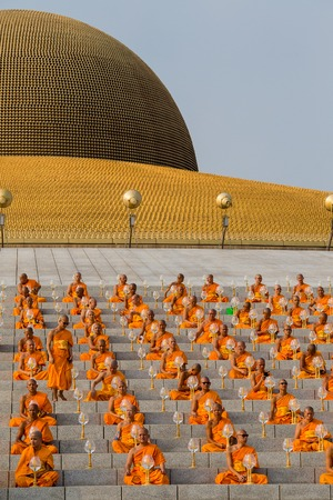 puja: BANGKOK,THAILAND - FEBRUARY 22, 2016: Unidentified Thai monks during Buddhist ceremony Magha Puja Day in Wat Phra Dhammakaya Editorial