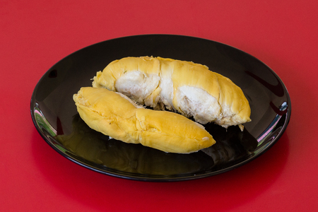 King of fruits in asia, durian on red background. Close up Stock Photo