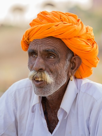 PUSHKAR, INDIA - OCTOBER 28, 2014: Unidentified Indian man attended the annual Pushkar Camel Mela. This fair is the largest camel trading fair in the world.