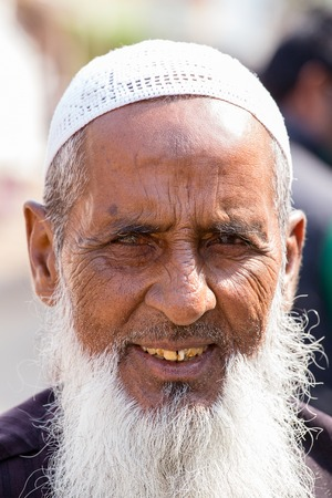 PUSHKAR, INDIA - OCTOBER 28, 2014: Unidentified Indian muslim man attended the annual Pushkar Camel Mela. This fair is the largest camel trading fair in the world.