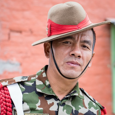 resolve: KATHMANDU, NEPAL - SEPTEMBER 29, 2016 : Portrait of a Gurkha warrior from the Nepalese Army in street Kathmandu .Gurkha warriors famous for their unquestionable loyalty, ambition, ferocity and resolve