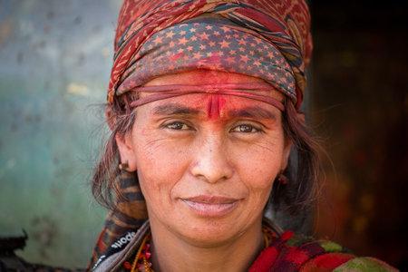 KATHMANDU, NEPAL - OCTOBER 25, 2016 : Portrait old poor women in traditional dress in street Kathmandu, Nepal