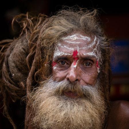 KATHMANDU, NEPAL - OCTOBER 25, 2016 : Portrait of Shaiva sadhu, holy man in Pashupatinath Temple . Close up
