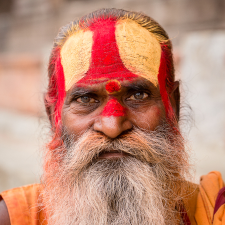 KATHMANDU, NEPAL - SEPTEMBER 29, 2016 : Portrait of Shaiva sadhu, holy man in Pashupatinath Temple . Close up