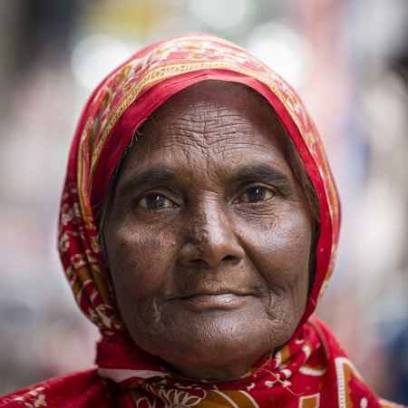 KATHMANDU, NEPAL - SEPTEMBER 29, 2016 : Portrait old women in traditional dress in street Kathmandu, Nepal