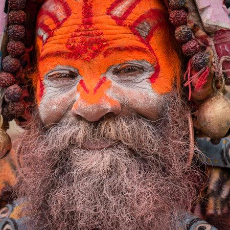 KATHMANDU, NEPAL - SEPTEMBER 29, 2016 : Portrait of Shaiva sadhu, holy man in Pashupatinath Temple . Close up