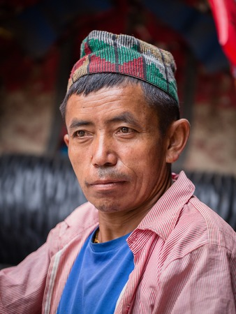 pauper: POKHARA, NEPAL - SEPTEMBER 29, 2016 : Portrait old men in traditional dress in street Pokhara, Nepal