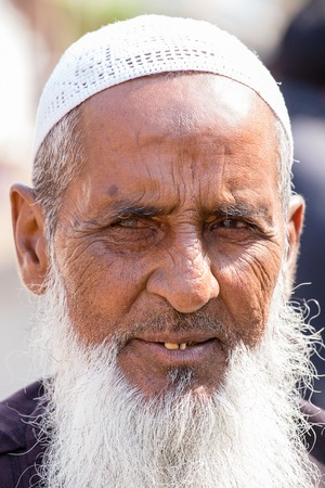 herder: PUSHKAR, INDIA - OCTOBER 28, 2014: Unidentified Indian muslim man attended the annual Pushkar Camel Mela. This fair is the largest camel trading fair in the world.