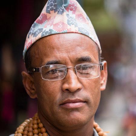 KATHMANDU, NEPAL - SEPTEMBER 28, 2016 : Portrait old men in traditional dress in street Kathmandu, Nepal
