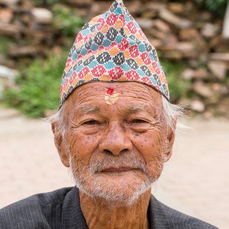 KATHMANDU, NEPAL - SEPTEMBER 29, 2016 : Portrait old men in traditional dress in street Kathmandu, Nepal