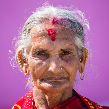 KATHMANDU, NEPAL - OCTOBER 07, 2016 : Portrait old woman in traditional dress in street Kathmandu, Nepal
