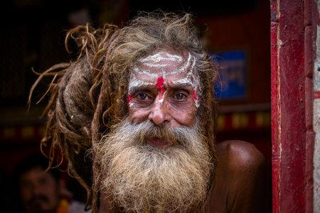 sadhu: KATHMANDU, NEPAL - OCTOBER 25, 2016 : Portrait of Shaiva sadhu, holy man in Pashupatinath Temple . Close up