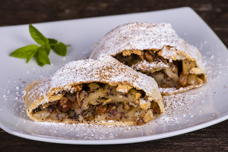 strudel: Slice of an apple strudel on a plate, Close up Stock Photo