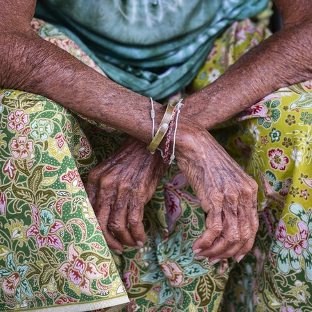 Aging process - very old senior woman hands wrinkled skin, close up. Thailand Stock Photo