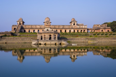 Jahaz Mahal , Ship Palace and blue water lake in sunrise. Mandu, Madhya Pradesh, India