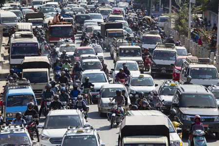 KATHMANDU, NEPAL - OCTOBER 25, 2016 : Traffic moves slowly along a busy road in Kathmandu, Nepal. Crowded traffic jam road in city