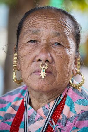 KATHMANDU, NEPAL - OCTOBER 23, 2016 : Portrait old women in traditional dress in street Kathmandu, Nepal