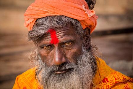 VARANASI, INDIA - JANUARY 25, 2017 : Portrait of Shaiva sadhu, holy man on the ghats of the Ganges river in Varanasi, India . Close up