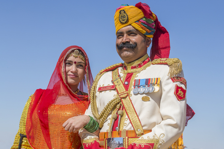 soldiers: JAISALMER, INDIA - FEBRUARY 09 2017 : Unidentified woman and man wearing traditional Rajasthani dress participate in Mr. Desert contest as part of Desert Festival in Jaisalmer, Rajasthan, India. Close up Editorial