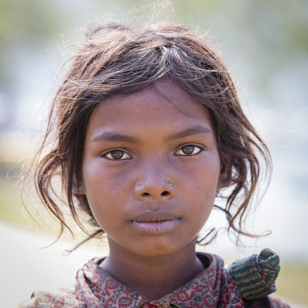 HIMALAYAS, ANNAPURNA REGION, NEPAL - OCTOBER 23, 2016 : Portrait nepalese child on the street in Himalayan village, Nepal