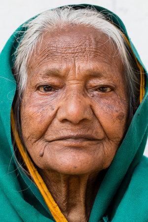 VARANASI, INDIA - JANUARY 26, 2017 : Portrait old beggar woman on street at Dashashwamedh Ghat in Varanasi, Uttar Pradesh, India