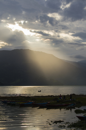 pokhara: Sunset in lake Phewa in Pokhara, Nepal, with the Himalayan mountains in the background Stock Photo