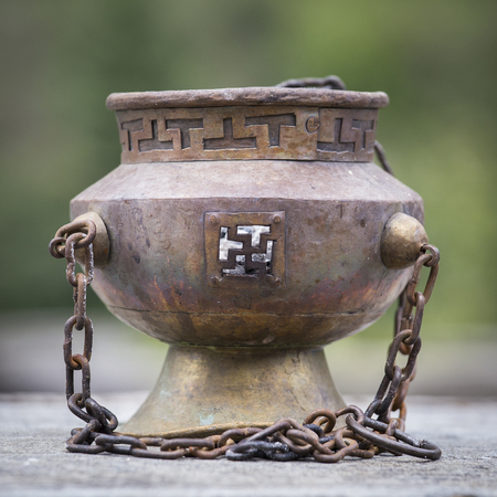 oil lamp: Tibetan Buddhist ceremonies lamp for religious ritual, Nepal . Close up