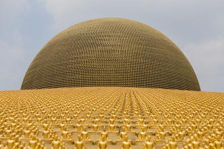 Million golden Buddha figurine in Wat Phra Dhammakaya. Buddhist temple in Bangkok, Thailand Stock Photo