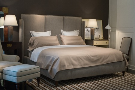 hotel building: BANGKOK, THAILAND - JANUARY 07, 2016 : Stylish bedroom interior design with brown and white pillows on bed in supermarket Siam Paragon. Siam Paragon is a one of the biggest shopping centres in Asia