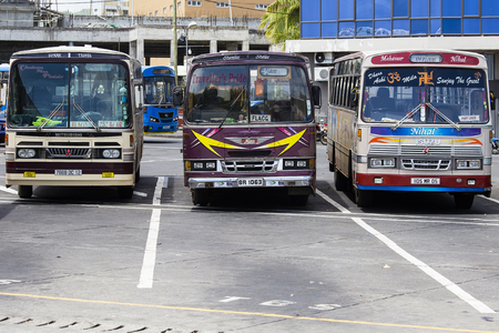 thoroughfare: PORT LOUIS, MAURITIUS - MARCH 06, 2017 : Regular public buses at the bus station. Buses are the most widespread public transport type in Mauritius Editorial