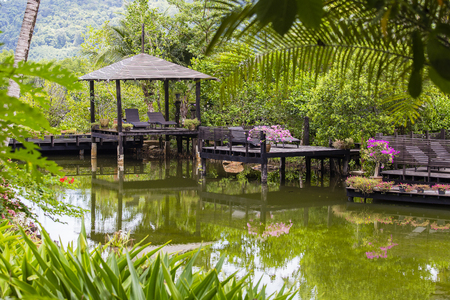 Pavilion for relaxing on a pond in a tropical garden, island Koh Chang, Thailand Stock Photo
