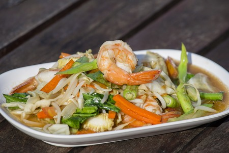 Thai food, seafood with vegetable spicy salad, close up