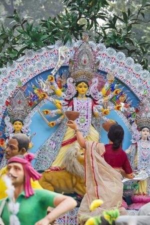 Goddess Kali during Durga Puja at a pandal display in New Delhi, India
